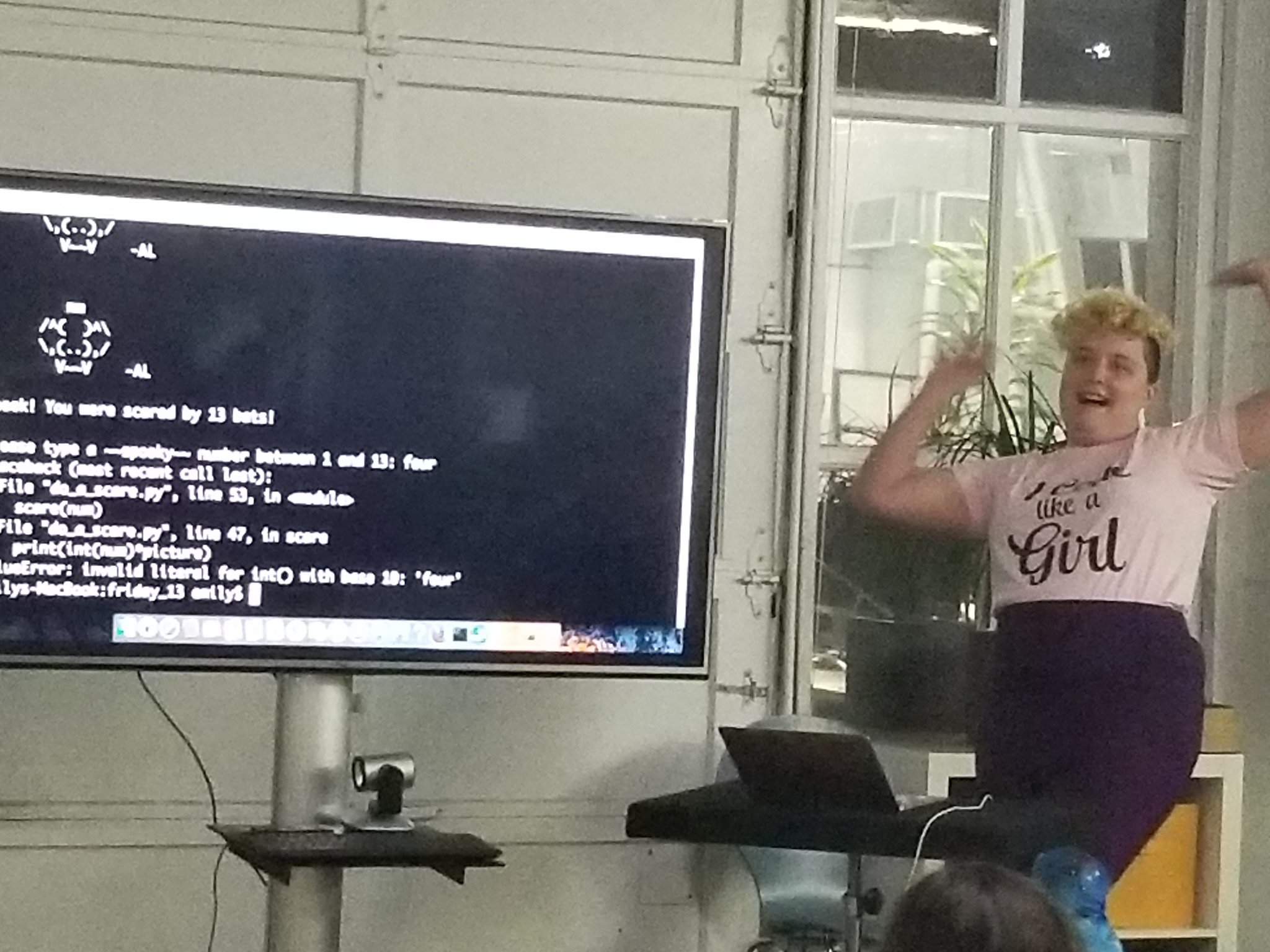 A picture of me presenting my spooky presentation, and screaming about a scary error message
